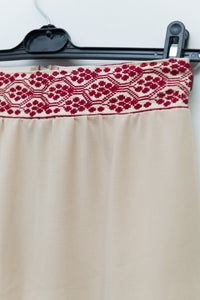 Beige short skirt with hand embroidered waist - Falastini Brand