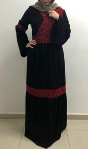 Embroidered black dress with Palestinian red threads