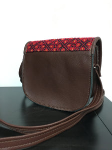 Hand embroidered leather handbag