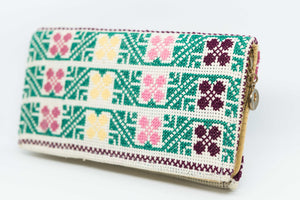 Hand embroidered white purse with green embroidery for personal stuff