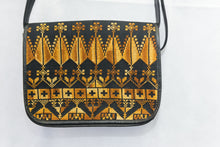 Hand embroidered black handbag with golden embroidery