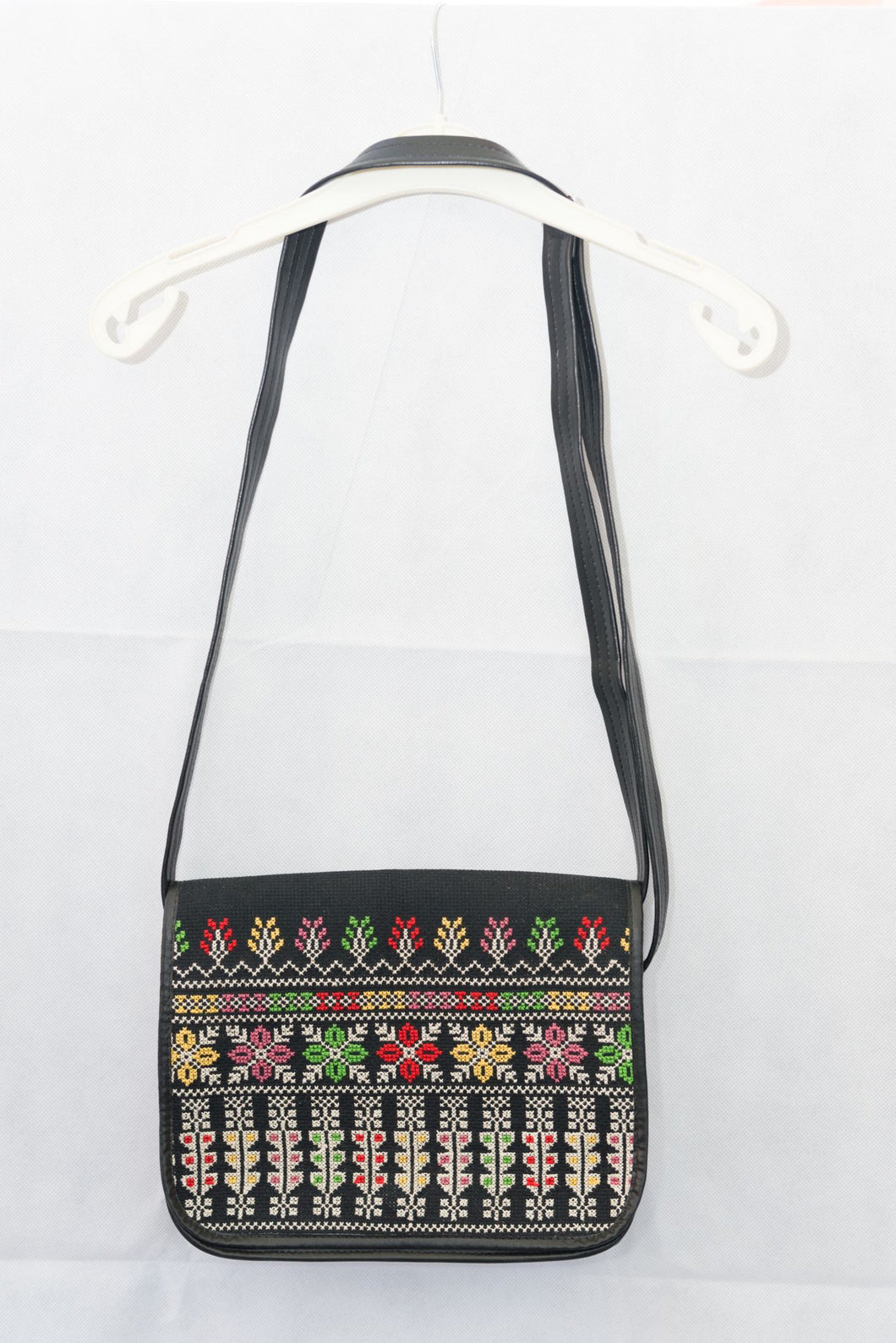 Hand embroidered black handbag with colorful embroidery
