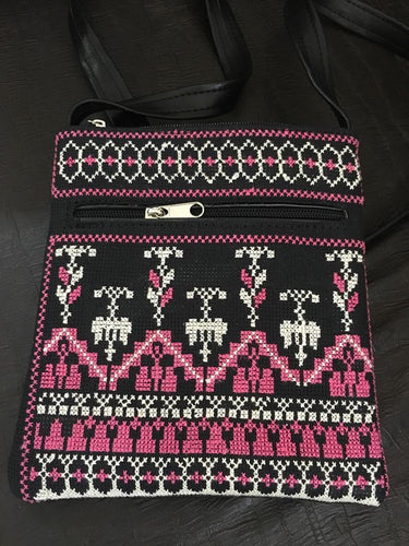 Small hand embroidered black handbag with pink embroidery