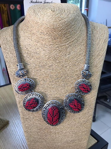 Hand embroidered necklace with red embroidery