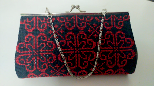 Embroidered red clutch