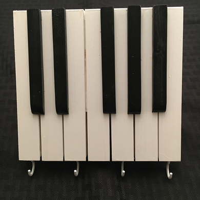 This is one of the most unique piano keyholder you will find anywhere. It will make a unique music gift for the piano décor themed room.