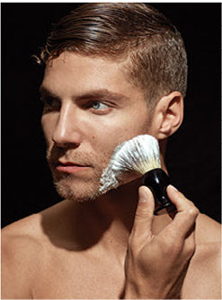 Model applying shaving cream with brush
