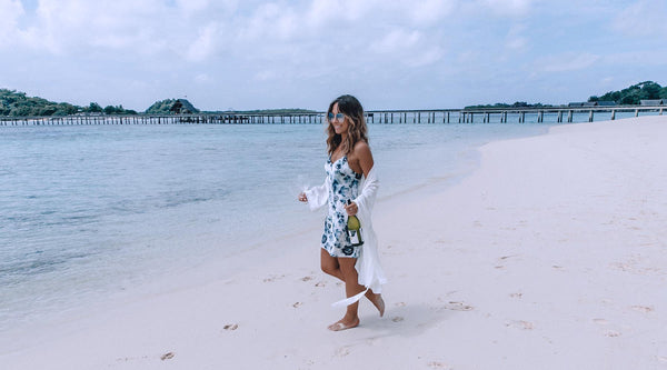 This Island Life walking on a beach in the London Print Slip and Ivory Silk Cotton Robe