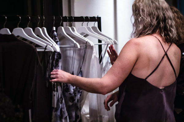 Woman looking at clothes on rack