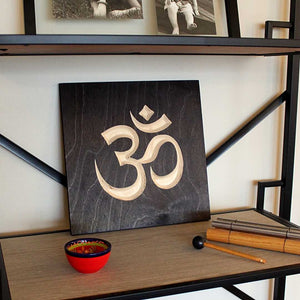 Om Symbol Wood Sign Pure Black on bookshelf