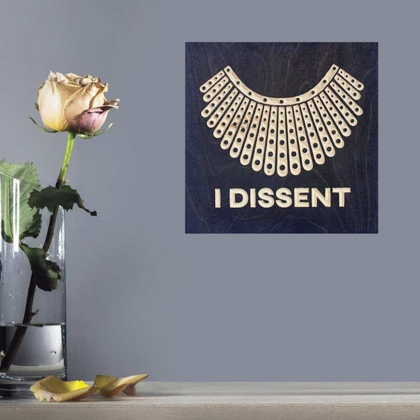 RBG Dissent Collar wood signs on wall with flower