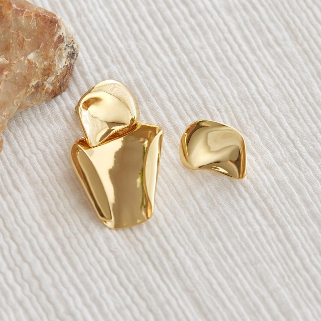 Flat lay photo of gold plated statement earrings.
