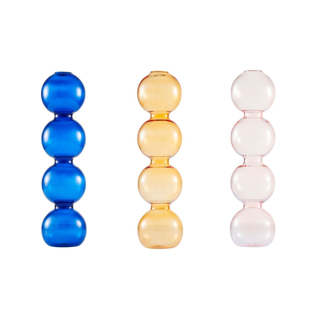 Product image of three coloured glass vases featuring four spheres, in blue, orange and pink.