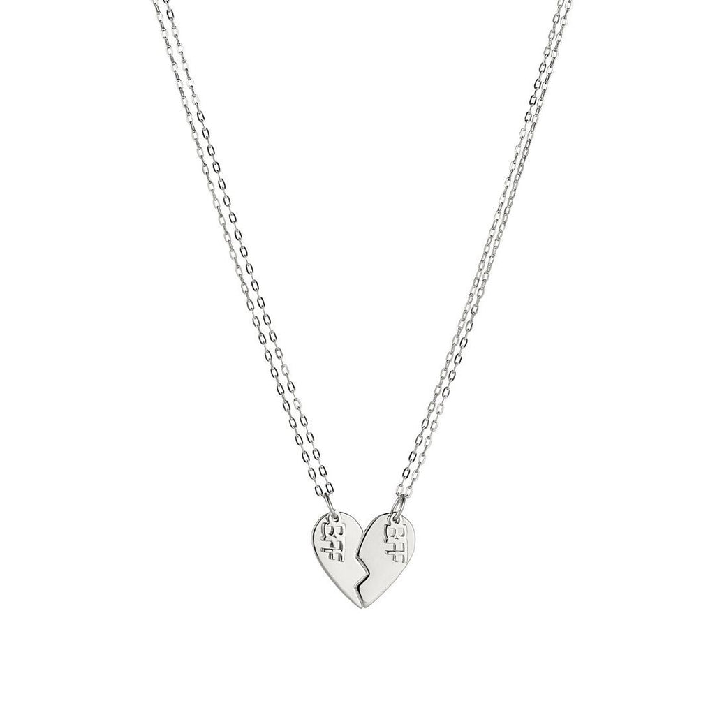 Product image of a pair of sterling silver best friend necklaces that when put together, make the shape of a heart. Each side of the heart has a charm attached with the word 'BFF'.