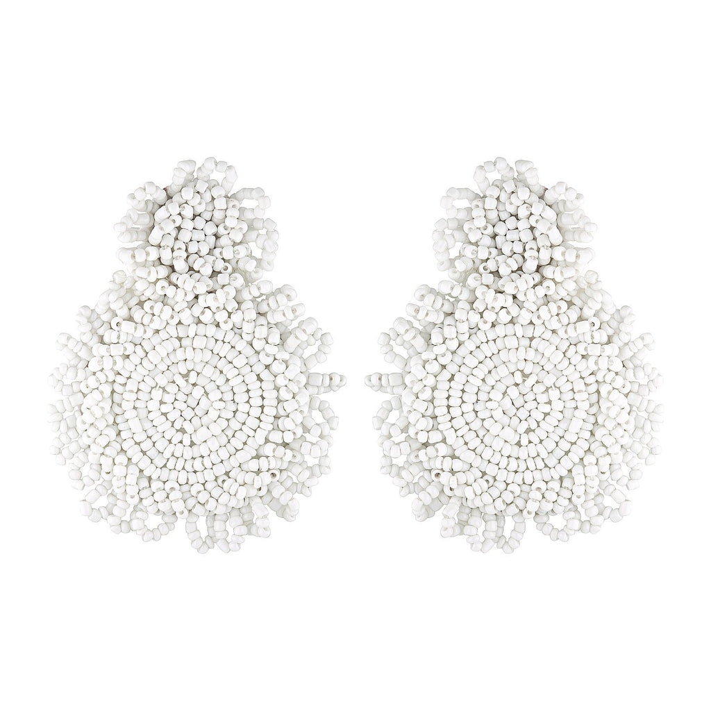 Product photo of oversized, micro bead statement earrings in white. The earrings have a small circle of beads at top and a larger circle of beads attaches to this and forms the drop section of the earring.
