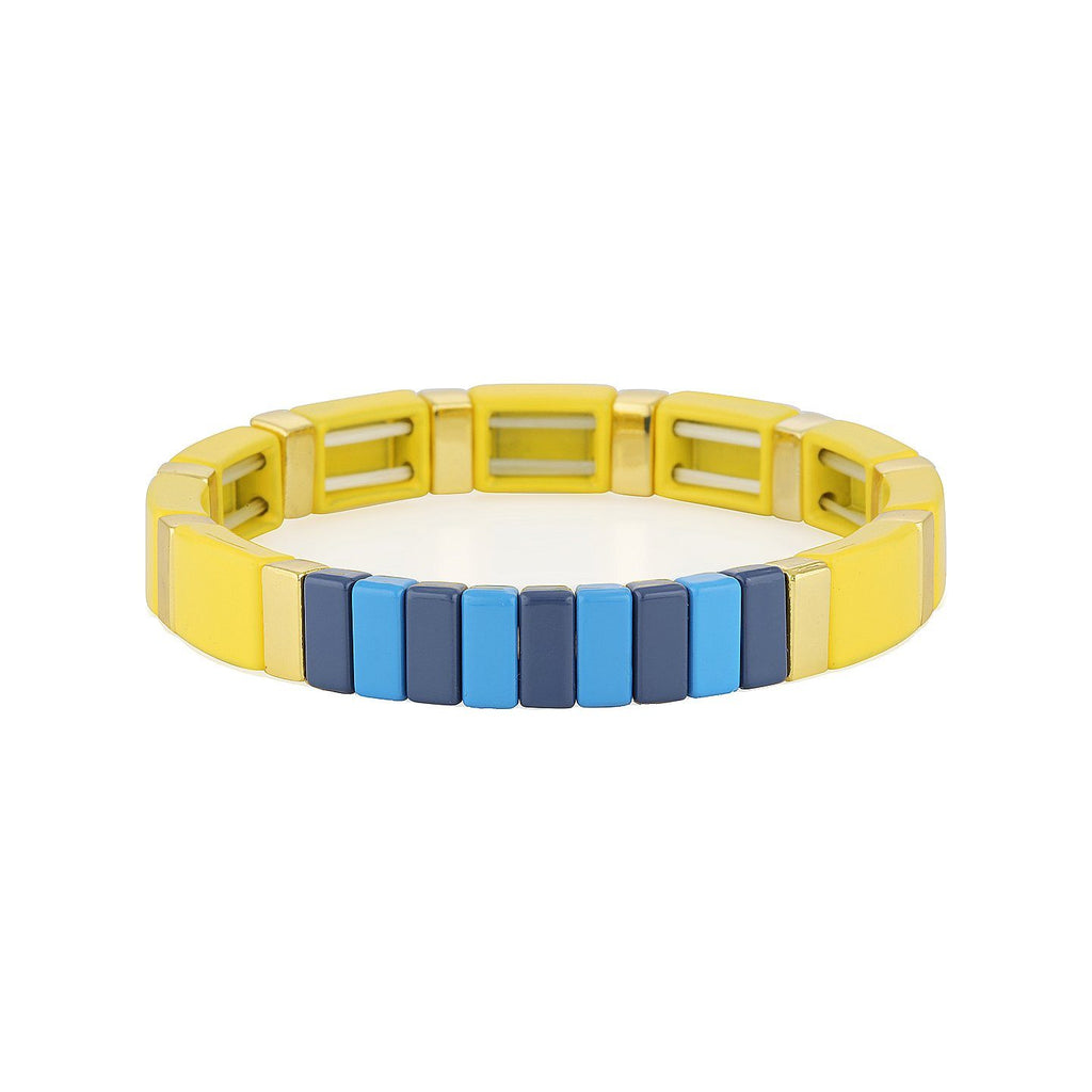 Product photo of colourful elasticised bracelet with square metal beads coated in a mix of yellow, sky blue and navy blue enamel.