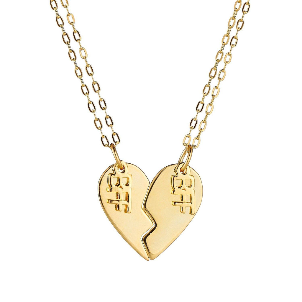 Product image of a pair of sterling silver best friend necklaces, with 14k gold plating, that when put together, make the shape of a heart. Each side of the heart has a charm attached with the word 'BFF'.