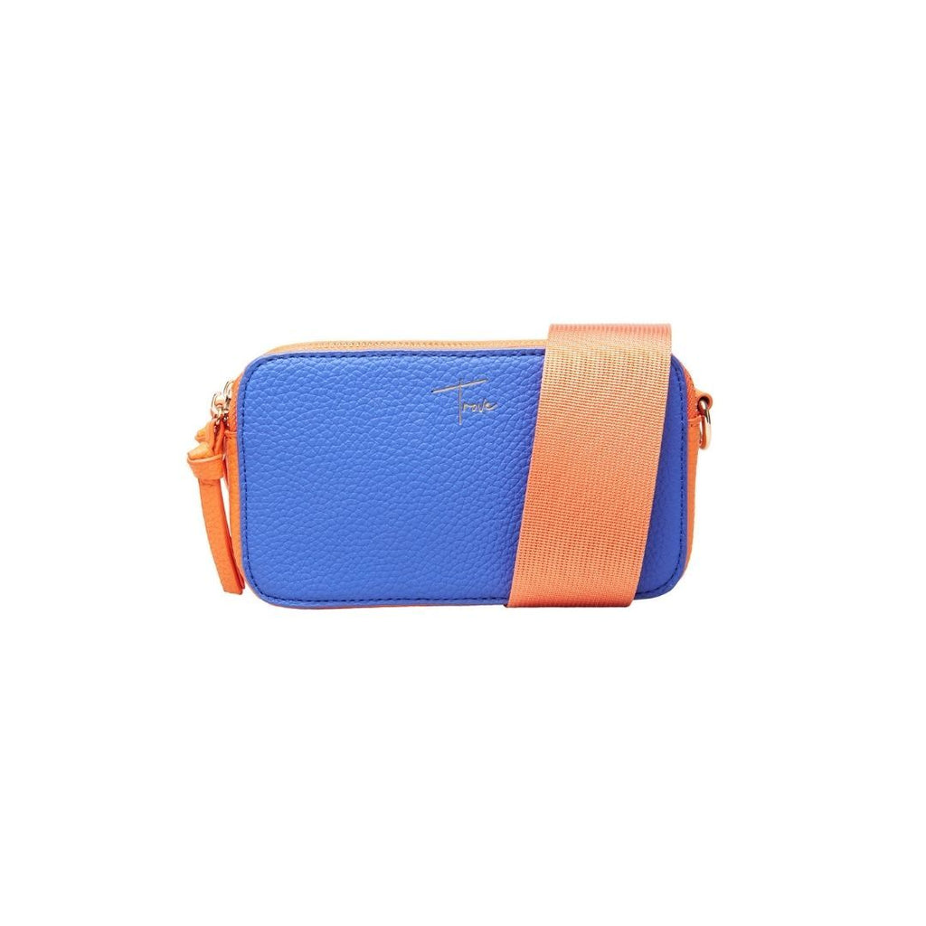 Product photo of double-sided camera bag in electric blue and beige, with orange strap and detailing. Front view.