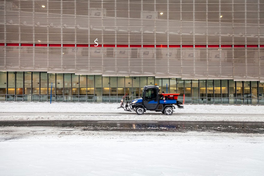 blue forklift in the snow