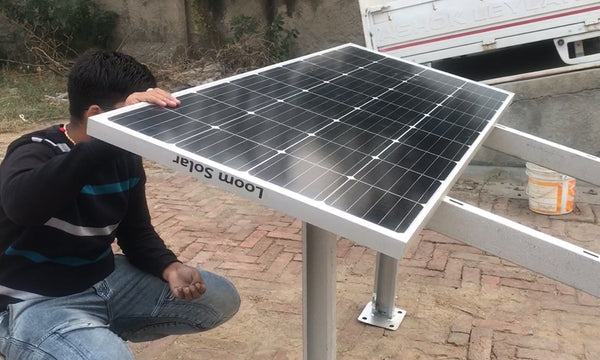 installing solar panels on panel stand
