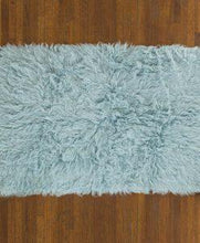 blue flokati rug in living room