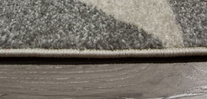 ginger and grey contemporary rug close up of edging