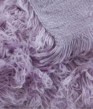 purple flokati rug in lounge