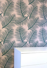 the room alive green on blush wallpaper close up with unit
