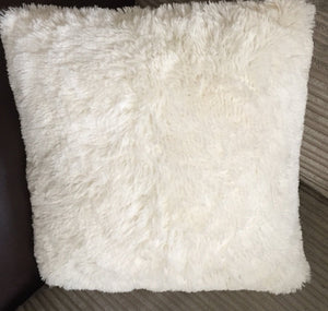 cream fluffy cushion