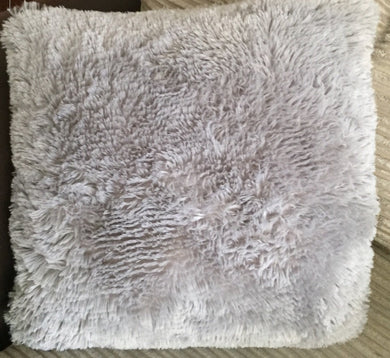 grey fluffy cushion