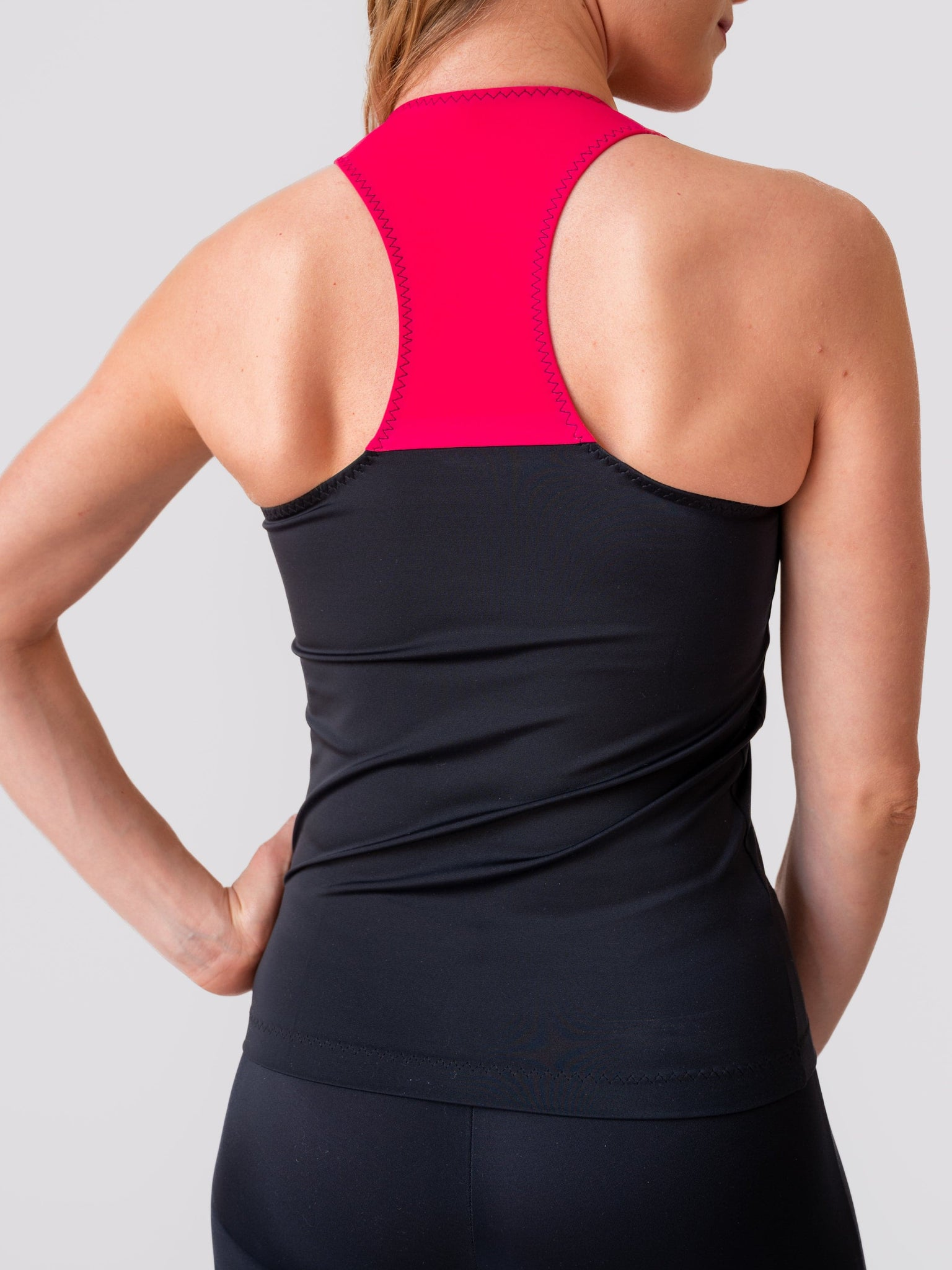 Black and fuchsia yoga and fitness tank tops for women and girls by Lena Activewear