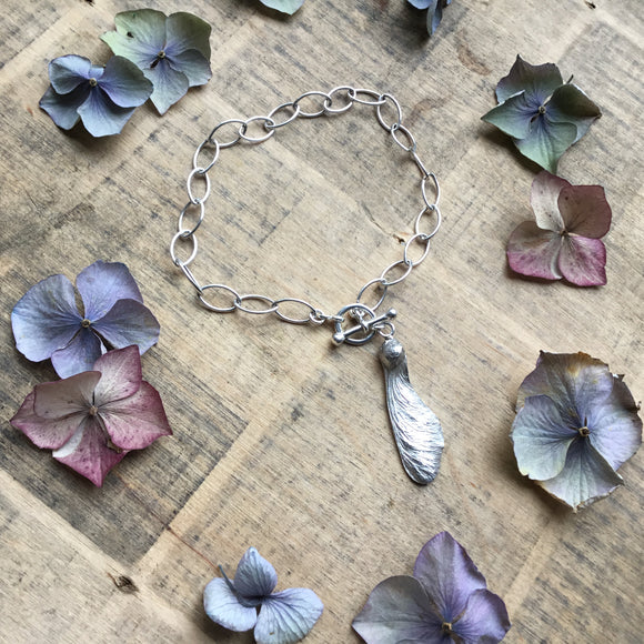 Sterling silver single sycamore charm bracelet