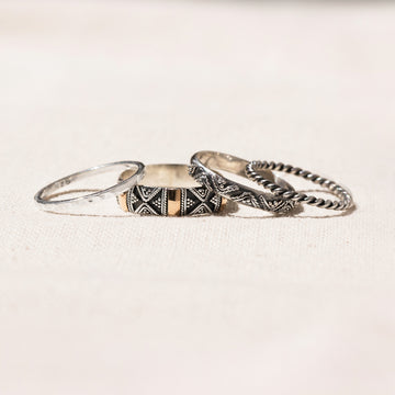 SET OF FOUR SILVER AND 18K GOLD GILDED STACKING RINGS - SYDNEY