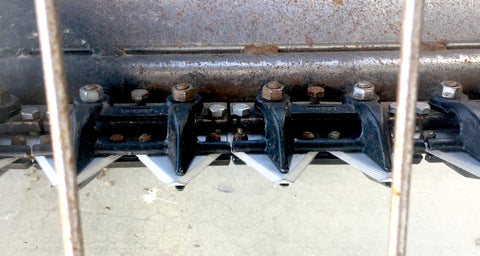 Swather header teeth