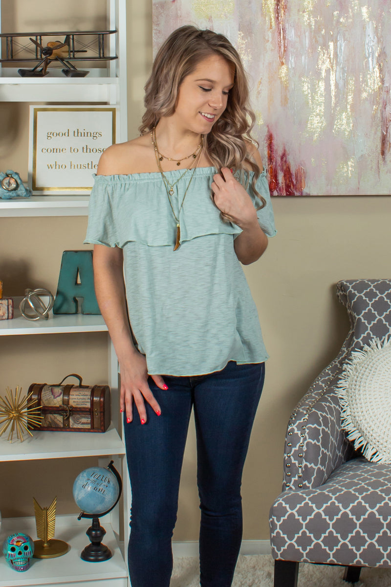 green ruffle top, green ruffle blouse