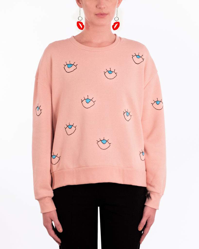 pink jumper handmade black embroidery blue eyes pattern