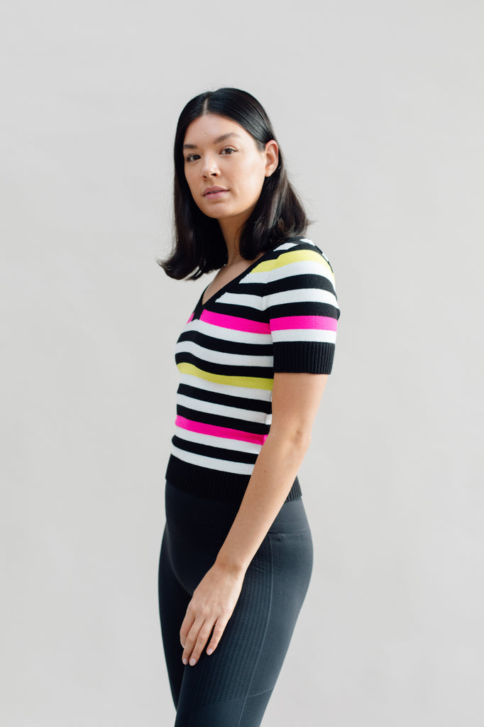 West Carolina Knitwear Collection - Camilla Top. Navy, yellow, pink, black and whiteknitted short sleeve top. Stay warm this season with our comfortable knitwear collection. Shop our colour blocked, rib-knit, high-neck jumper top with coloured stripes. Perfect for staying warm during this Autumn/Winter season!