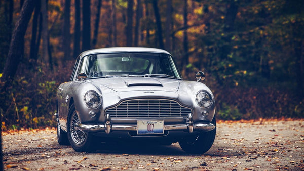 Aston Martin: The quintessential gentleman's car.