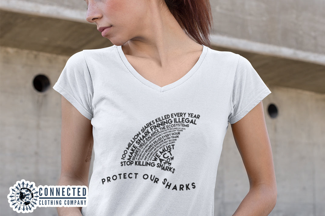 Model Wearing White Protect Our Sharks Short-Sleeve Vneck Tshirt - Connected Clothing Company - Ethically and Sustainably Made - 10% donated to Oceana shark conservation