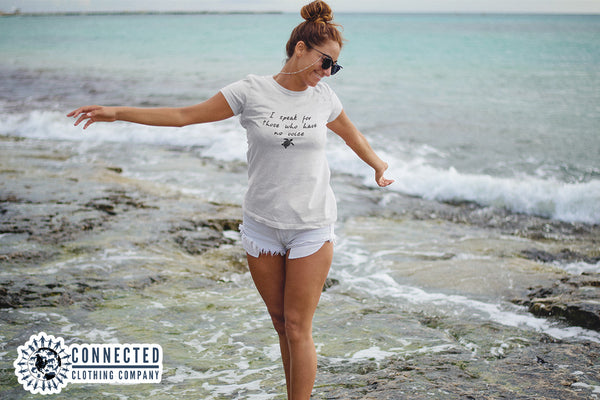 Model wearing White Be The Voice Sea Turtle Short-Sleeve Tee on the beach Connected Clothing Company - Ethically and Sustainably Made - 10% donated to the Sea Turtle Conservancy