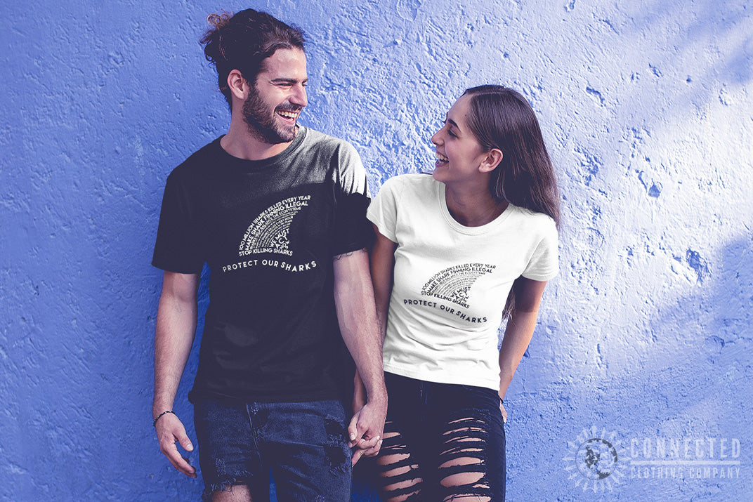 Couple wearing Connected Clothing Company Protect Our Sharks Tee in White and Black