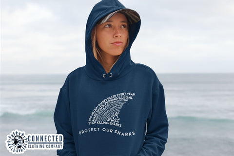 Model wearing Navy Protect Our Sharks Hoodie - Connected Clothing Company Blog - 7 Eco-friendly Companies That Give Back To Our Planet
