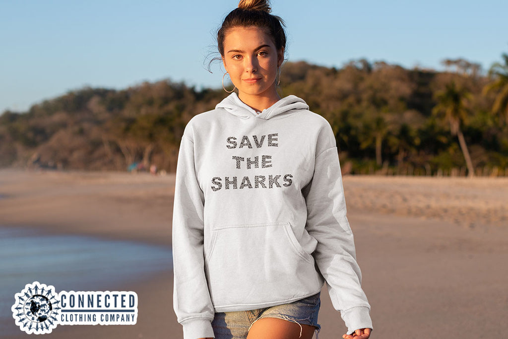 woman on the beach wearing White Save The Sharks Unisex Hoodie - Connected Clothing Company - Ethically and Sustainably Made - 10% donated to Oceana shark conservation
