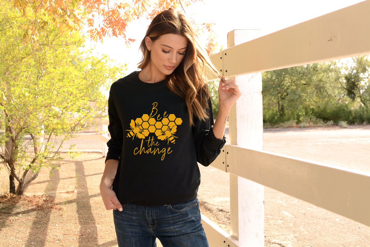 model wearing black Bee The Change Long-Sleeve Tee - Connected Clothing Company - 10% donated to building bee habitats