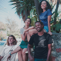 group of friends smiling while wearing Connected Clothing Company shirts - ethically and sustainably made products that give back to non-profit organizations