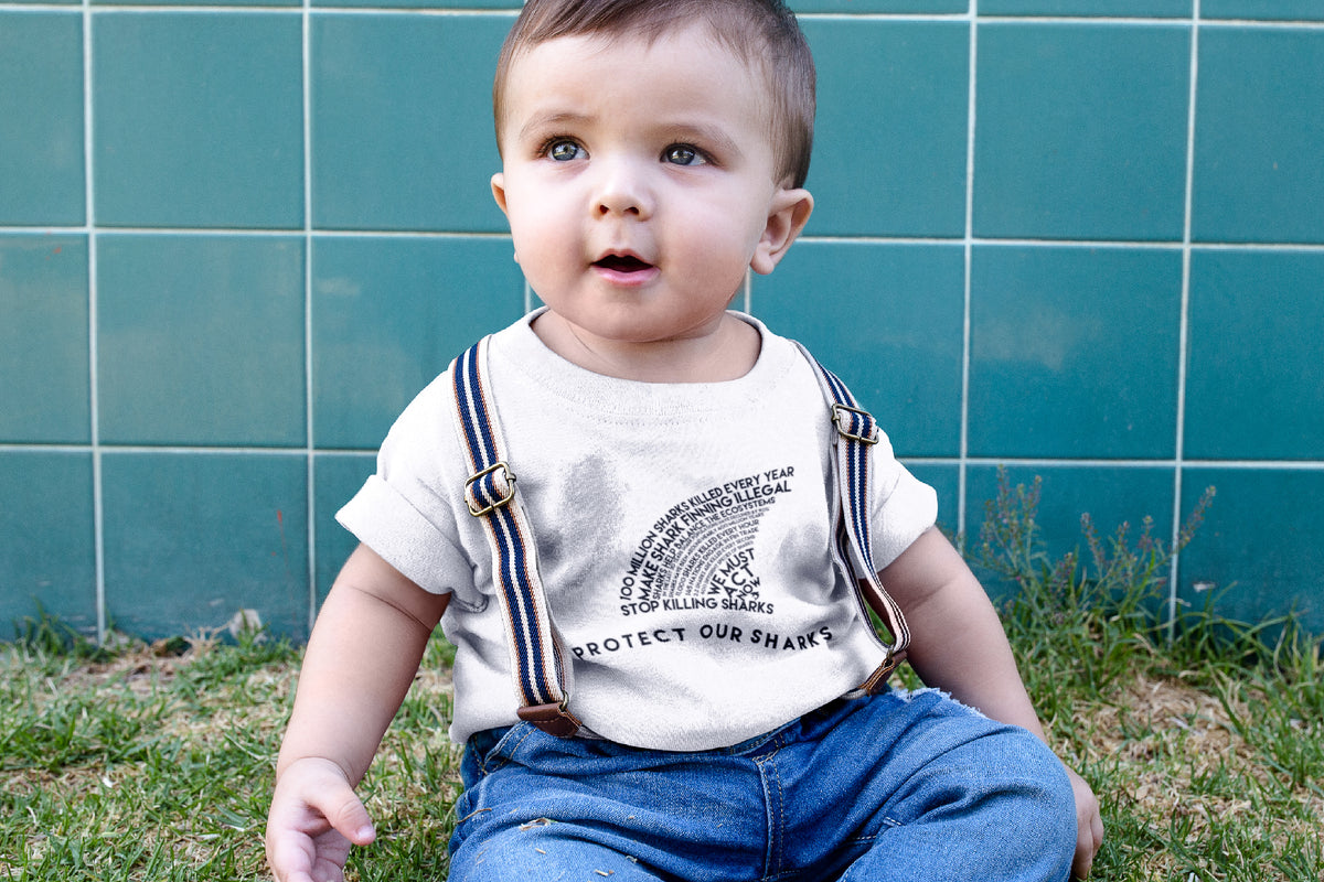 toddler wearing white Protect Our Sharks Toddler Short-Sleeve Tee - Connected Clothing Company - 10% of profits donated to shark conservation