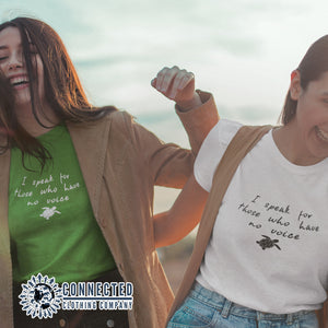 "2 Friends Wearing A Kelly Green Be The Voice Sea Turtle Tee reads ""I speak for those who have no voice."" And A White Tee - Connected Clothing Company - Ethically and Sustainably Made - 10% donated to the Sea Turtle Conservancy"