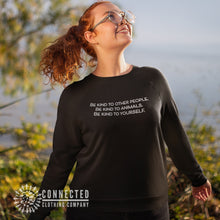 "Load image into Gallery viewer, Model wearing Black Be Kind To All Sweatshirt reads ""Be kind to other people. Be kind to animals. Be kind to yourself."" - Connected Clothing Company - Ethically and Sustainably Made- 10% donated to Mission Blue ocean conservation"