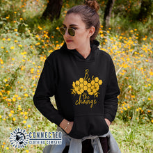 Load image into Gallery viewer, Model Wearing Black Bee The Change Unisex Hoodie - Connected Clothing Company - Ethically and Sustainably Made - 10% donated to The Honeybee Conservancy