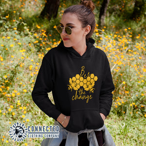 Model Wearing Black Bee The Change Unisex Hoodie - Connected Clothing Company - Ethically and Sustainably Made - 10% donated to The Honeybee Conservancy